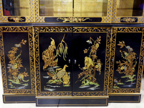 Drexel Heritage - black and gold chinoiserie China cabinet with glass shelves.