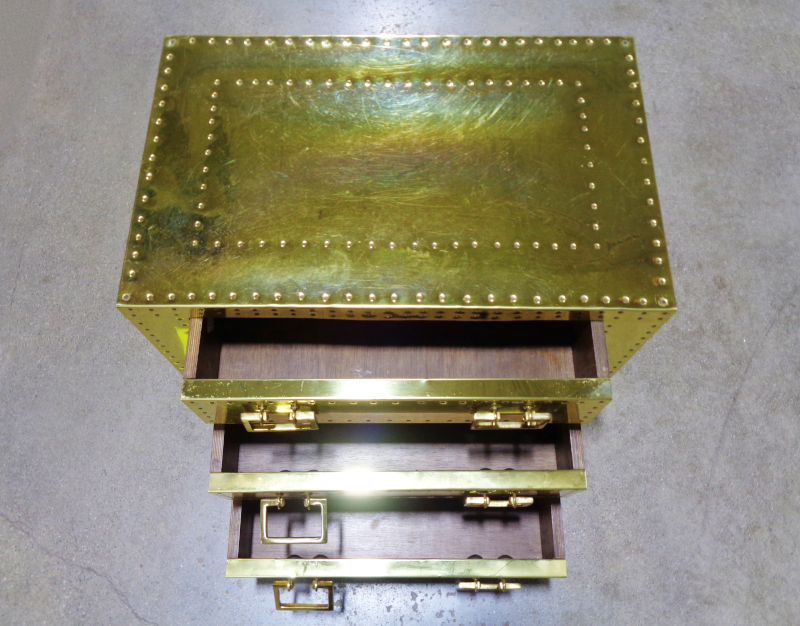 Brass Three-Drawer Riveted Chest.