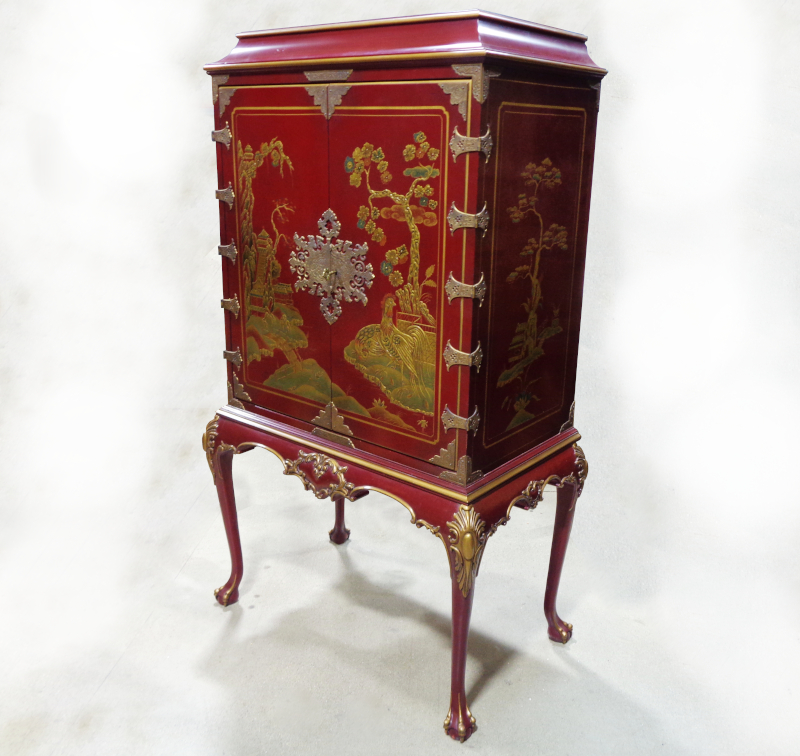Karges, red and gold painted chinoiserie style TV/bar cabinet.