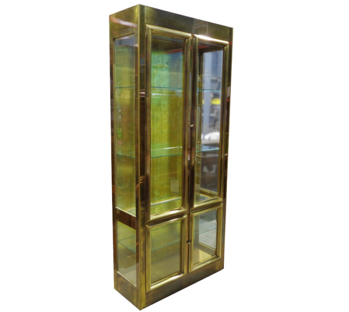 Mastercraft - Brass and glass display cabinet with glass shelves.