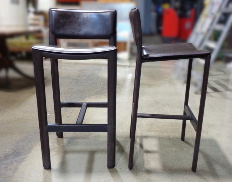 Pair of modern leather bar stools.