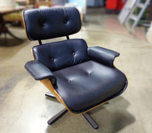 Style of Charles and Ray Eames for Herman Miller lounge chair with vinyl upholstery.