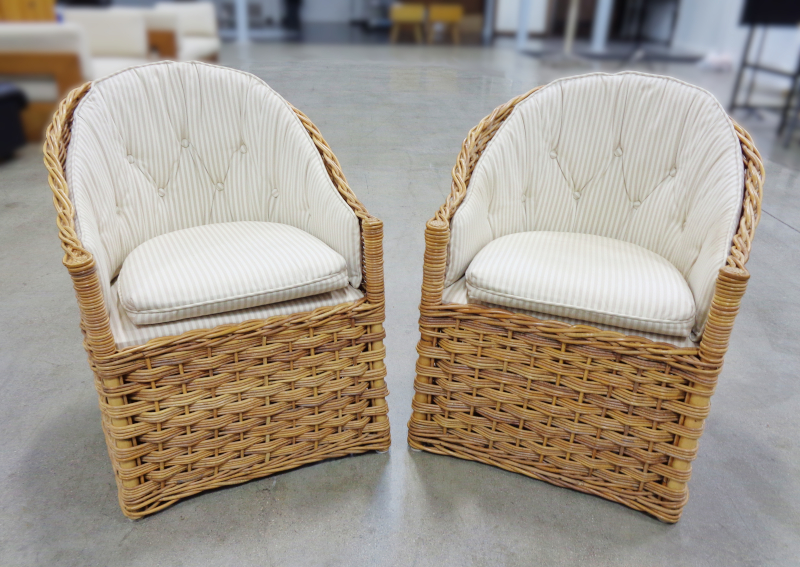 Pair of wicker lounge chairs with cream stripe upholstery