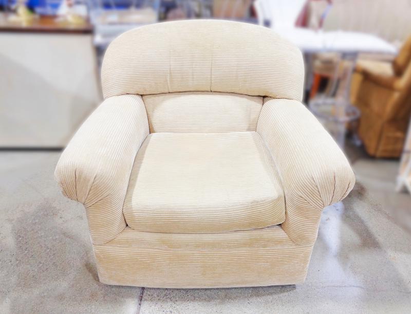 Century - beige corduroy upholstered armchair.