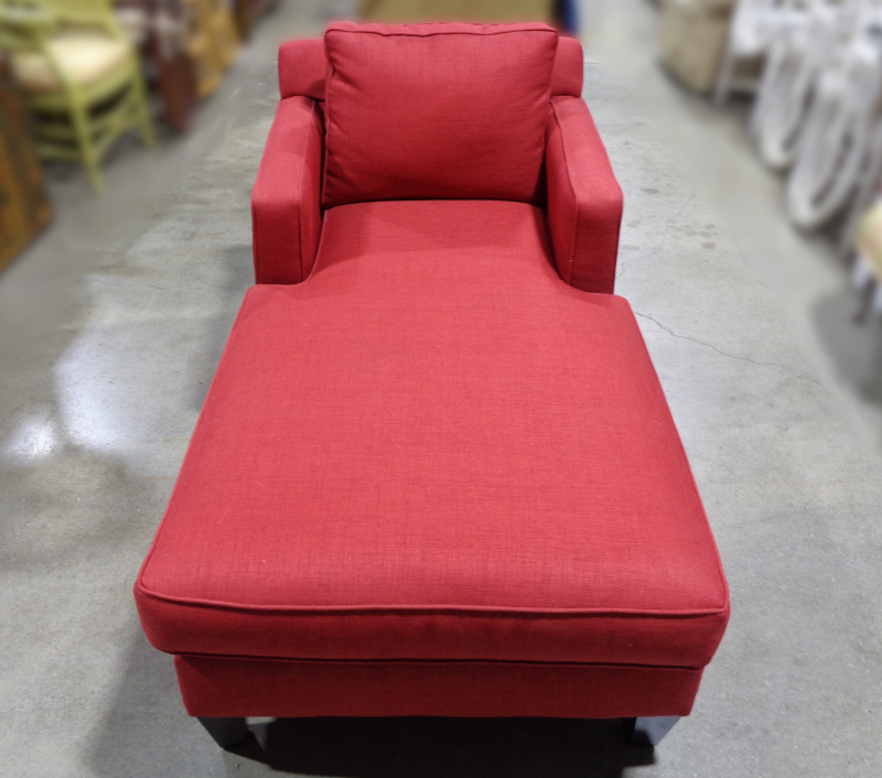 Bauhaus Furniture, red upholstered chaise lounge with accent pillows.