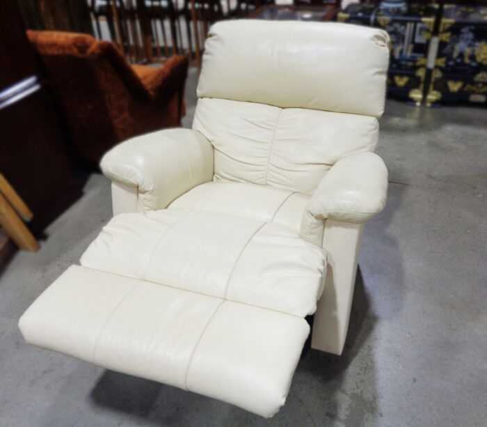 Beige leather lounge chair.