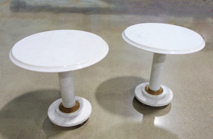 Pair of round white marble occasional tables.