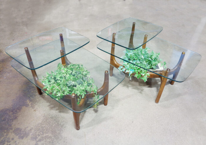Pair of mid-century wood and glass step tables.