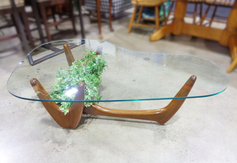 Mid-century wood and glass coffee table.