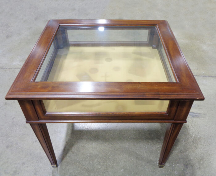 Square wood and glass display table.