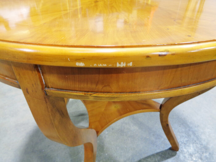 Round pine end table.