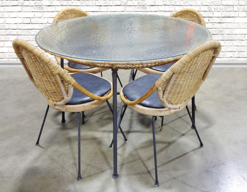 Rattan, metal, and glass patio set