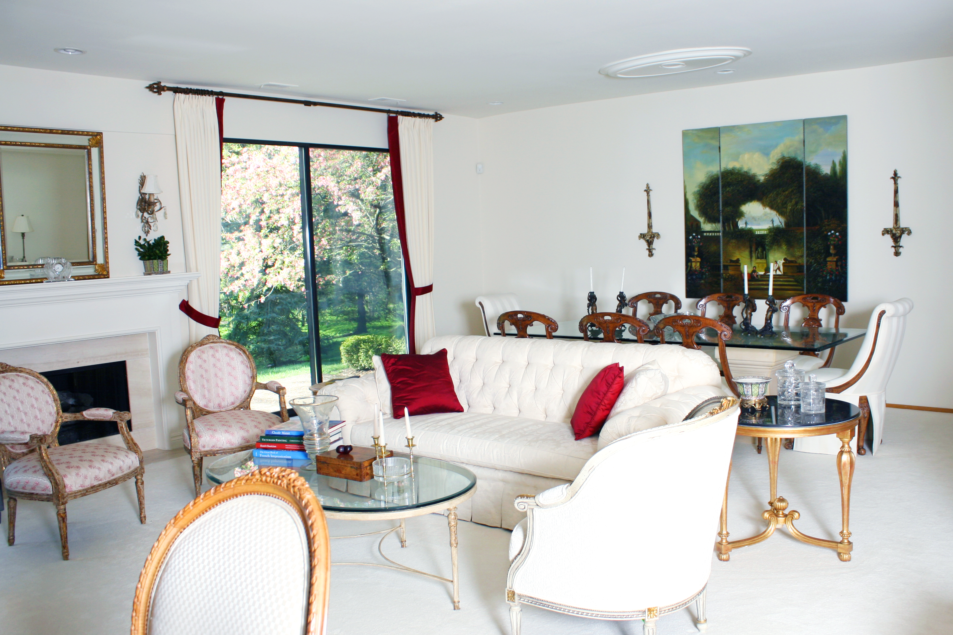 Interior of an estate sale with white furniture